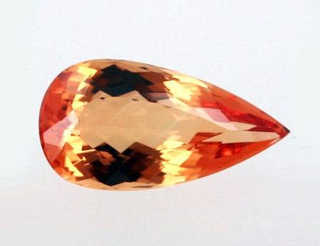 Красновато-оранжевый империал топаз