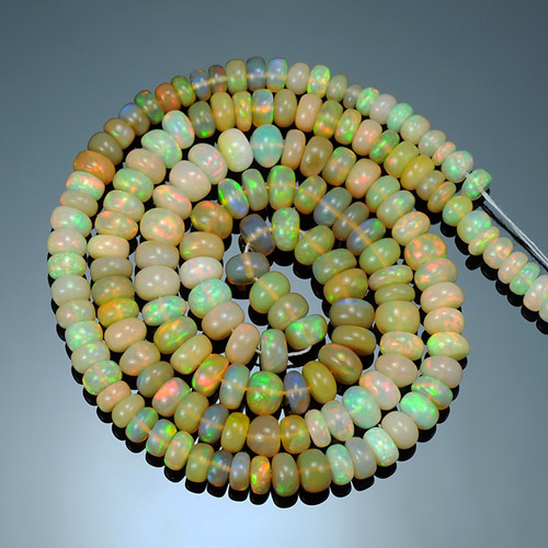 Natural Ethiopian Light Yellow base Multi color play Welo Opal Round Beads 45.47 Ct
