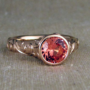 Natural padparadscha sapphire in gold ring