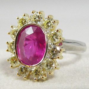 Pink sapphire in gold ring with diamonds